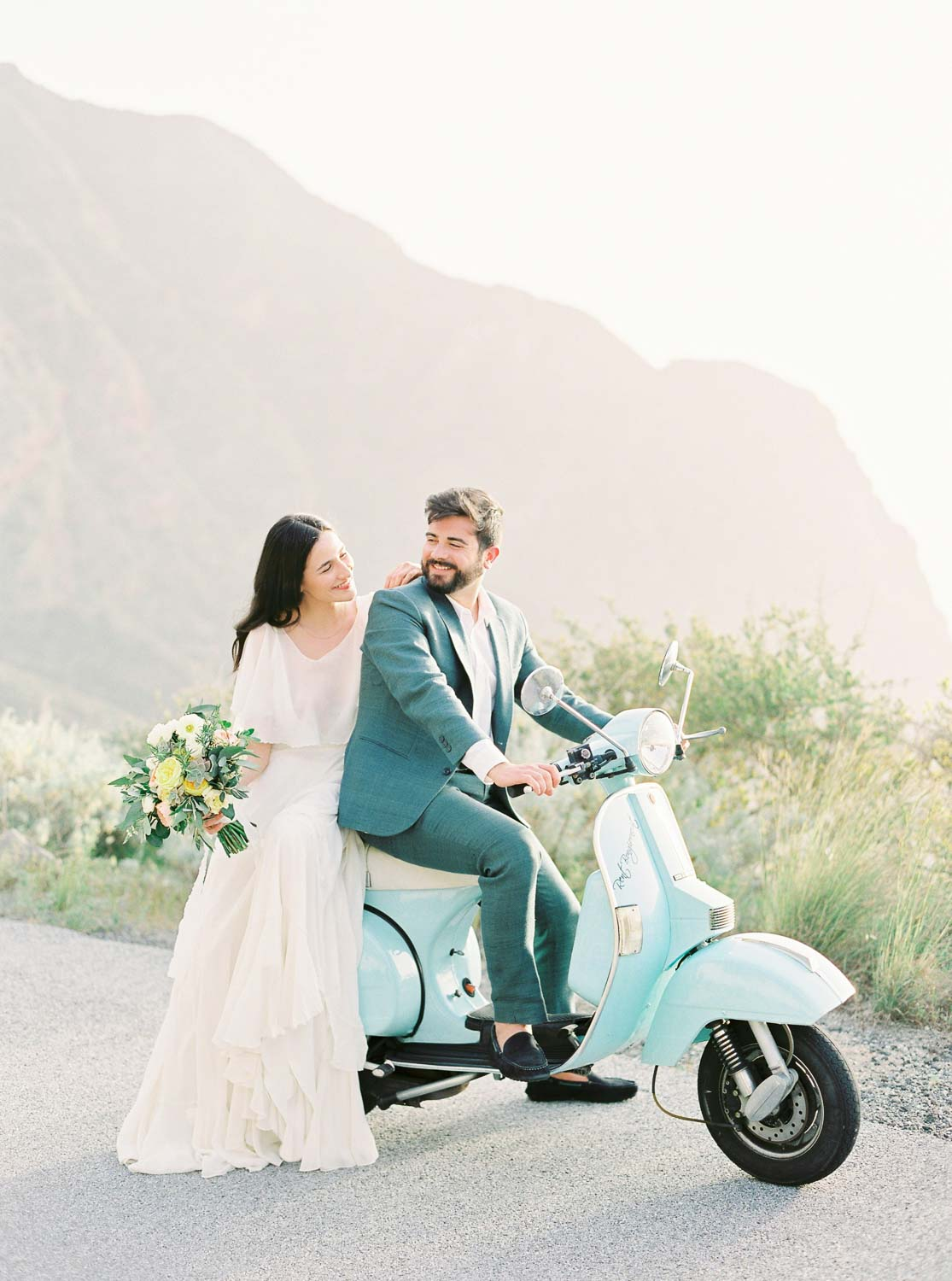 Bride and groom on Vespa PX