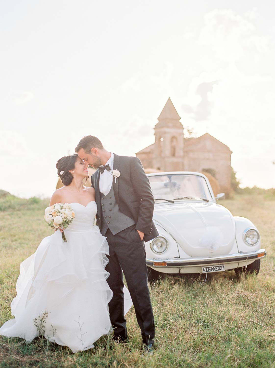 bride and groom with classic vw beetle
